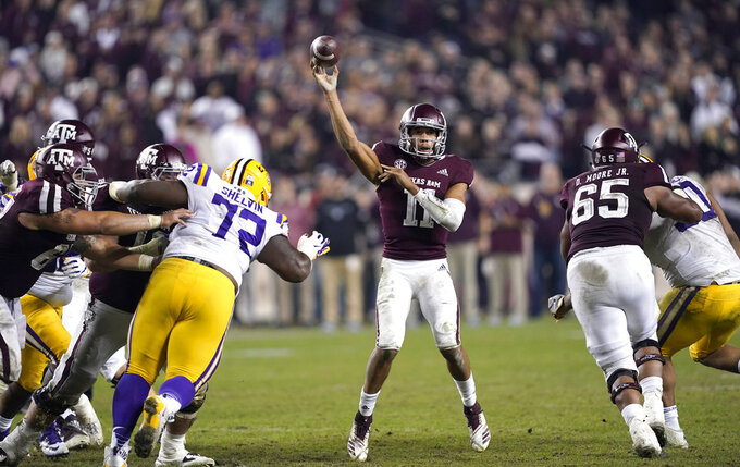 Texas A&M quarterback Kellen Mond (11) throws a pass against LSU during overtime of an NCAA college football game Saturday, Nov. 24, 2018, in College Station, Texas. Texas A&M won 74-72 in seven overtimes.(AP Photo/David J. Phillip)