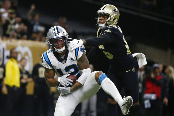 Carolina Panthers wide receiver D.J. Moore (12) catches a pass for a touchdown, as New Orleans Saints cornerback P.J. Williams (26) attempts to defend, during the second half at an NFL football game, Sunday, Nov. 24, 2019, in New Orleans. (AP Photo/Butch Dill)