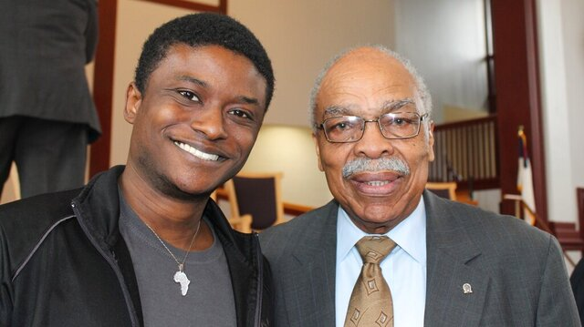 J'Kobe Kelley-Mills, a junior at Benedict College, and civil rights activist James L. Felder, pose for a photo after a workshop on African Americans and the vote held at Benedict College, a historically black college in Columbia, S.C., on Tuesday, Feb. 18, 2020. Black voters aren't unanimous in their choice in the South Carolina Democratic presidential primary, scheduled for Saturday, Feb. 29. (AP Photo/Skip Foreman)