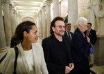 U2 lead singer Bono, center, walks on Capitol Hill in Washington, Tuesday, June 19, 2018. (AP Photo/Alex Brandon)