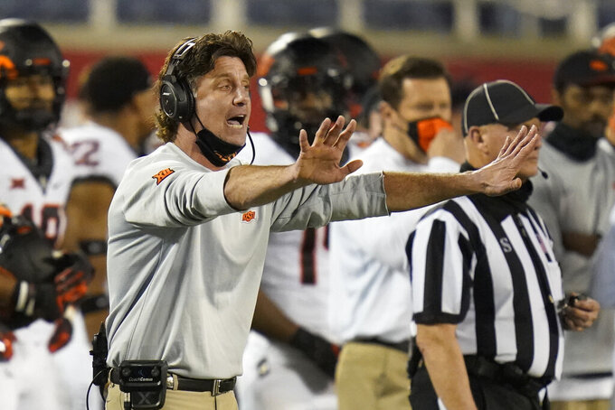 Oklahoma State head coach Mike Gundy shouts instructions to his players during the second half of the Cheez-it Bowl NCAA college football game against Miami, Tuesday, Dec. 29, 2020, in Orlando, Fla. (AP Photo/John Raoux)