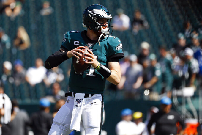 Philadelphia Eagles' Carson Wentz warms up before an NFL football game against the Detroit Lions, Sunday, Sept. 22, 2019, in Philadelphia. (AP Photo/Michael Perez)