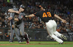 Arizona Diamondbacks' Tim Locastro, left, is tagged out by San Francisco Giants' Sam Dyson (49) during the seventh inning of a baseball game Saturday, June 29, 2019, in San Francisco. (AP Photo/Ben Margot)