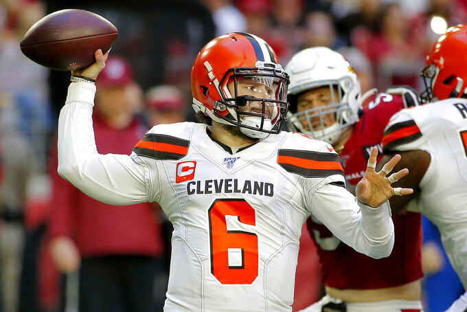 Cleveland Browns quarterback Baker Mayfield (6) throws against the Arizona Cardinals during the first half of an NFL football game, Sunday, Dec. 15, 2019, in Glendale, Ariz. (AP Photo/Rick Scuteri)