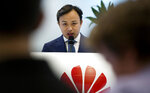 Abraham Liu, Chief Representative of Huawei to the European Institutions speaks during a DigitALL lunch talk in Brussels, Tuesday, May 21, 2019. (AP Photo/Virginia Mayo)