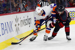 Carolina Hurricanes' Andrei Svechnikov (37), of Russia, battles with New York Islanders' Scott Mayfield (24) for the puck during the first period of an NHL hockey game in Raleigh, N.C., Sunday, Jan. 19, 2020. (AP Photo/Karl B DeBlaker)