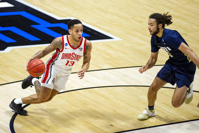 Ohio State's CJ Walker (13) drives against Oral Roberts' Kareem Thompson during the first half of a First Round game in the NCAA men's college basketball tournament, Friday, March 19, 2021, at Mackey Arena in West Lafayette, Ind. (AP Photo/Robert Franklin)