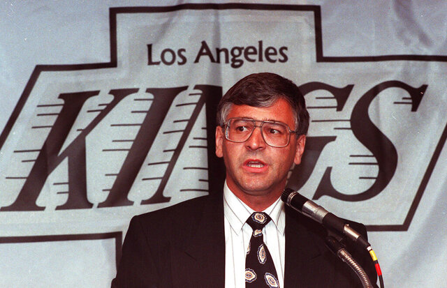 FILE - In this May 31, 1989, file photo, Tom Webster talks to reporters in Inglewood, Calif., after he was named coach of the Los Angeles Kings NHL hockey team. Webster, the former NHL and WHA forward who went on to coach the New York Rangers and the Kings, died Friday, April 10, 2020. He was 71. The Carolina Hurricanes announced Webster's death. (AP Photo/Nick Ut, File)