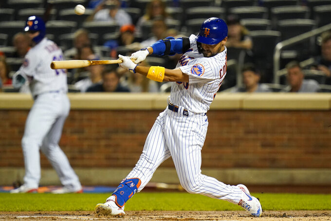 New York Mets' Michael Conforto hits an RBI single during the first inning of the team's baseball game against the St. Louis Cardinals on Tuesday, Sept. 14, 2021, in New York. (AP Photo/Frank Franklin II)