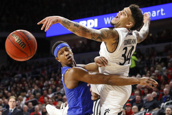Cincinnati's Jarron Cumberland (34) and SMU's William Douglas, left, vie for a loose ball during the first half of an NCAA college basketball game Saturday, Feb. 2, 2019, in Cincinnati. (AP Photo/John Minchillo)