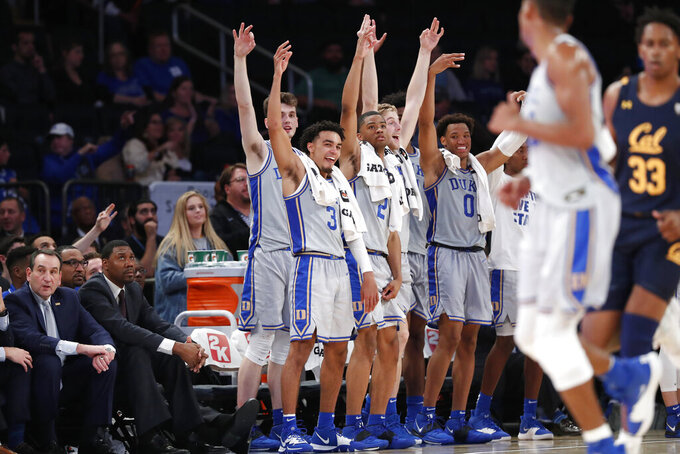 Duke starters react to a play as they watch from the bench late in the second half of the team's NCAA college basketball game against California in the 2K Empire Classic, Thursday, Nov. 21, 2019, in New York. Duke defeated California 87-52. (AP Photo/Kathy Willens)