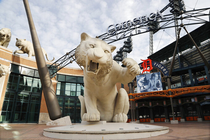 FILE - This Monday, Feb. 3, 2020, file photo shows the exterior of Comerica Park, home of the Detroit Tigers, in Detroit. The Tigers will play soon at Comerica Park, one of three sporting venues clustered within a mile of each other in the Motor City. With professional teams from four major leagues playing so close to each other, downtown Detroit is unique. And, that makes the COVID-19 pandemic hit a little harder here. For businesses in the area it has lately been a bust for those banking on a revenue stream from fans. (AP Photo/Carlos Osorio, File)