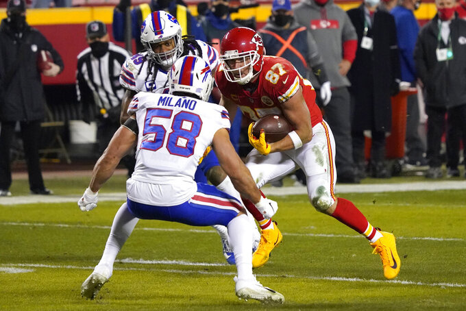 Kansas City Chiefs tight end Travis Kelce (87) runs from Buffalo Bills linebacker Matt Milano (58) after catching a pass during the first half of the AFC championship NFL football game, Sunday, Jan. 24, 2021, in Kansas City, Mo. (AP Photo/Jeff Roberson)