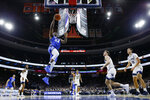 Creighton's Denzel Mahoney goes up for a shot during the first half of an NCAA college basketball game against Villanova, Saturday, Feb. 1, 2020, in Philadelphia. (AP Photo/Matt Slocum)