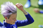 United States' Megan Rapinoe adjusts her hair before the start of a training session at the Gymnase Parc des Sports in Limonest, outside Lyon, France, a day before their Women's World Cup final match against the Netherlands, Saturday, July 6, 2019. (AP Photo/Alessandra Tarantino)
