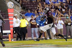 Texas A&M wide receiver Ainias Smith (0) cross the goal line for a touchdown against Kent State during the second half of an NCAA college football game on Saturday, Sept. 4, 2021, in College Station, Texas. (AP Photo/Sam Craft)