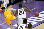 Drexel's Matey Juric (15) keep the ball from going out of bounds as Illinois guard Da'Monte Williams defends during the first half of a first round NCAA college basketball tournament game Friday, March 19, 2021, at the Indiana Farmers Coliseum in Indianapolis .(AP Photo/Charles Rex Arbogast)