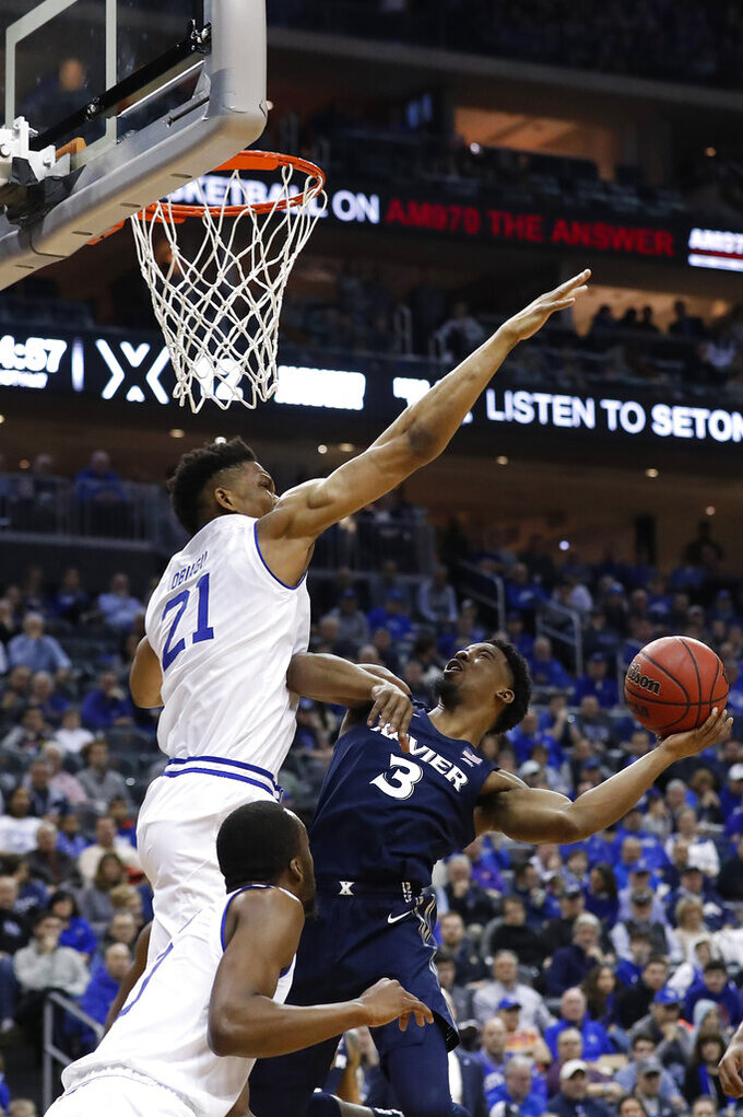 Seton Hall's Ike Obiagu (21) defends against Xavier's Quentin Goodin (3) during the first half of an NCAA college basketball game, Saturday, feb. 1, 2020, in Newark, N.J. (AP Photo/Michael Owens)