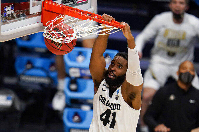 Colorado forward Jeriah Horne (41) gets a basket on a dunk against Georgetown in the second half of a first-round game in the NCAA men's college basketball tournament at Hinkle Fieldhouse in Indianapolis, Saturday, March 20, 2021. Colorado defeated Georgetown 96-73. (AP Photo/Michael Conroy)