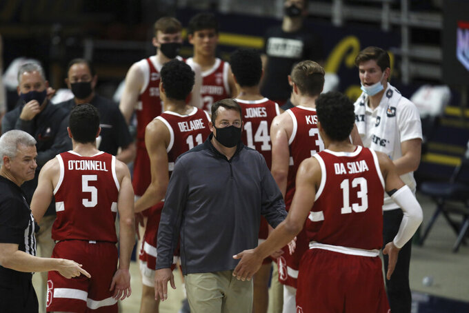 Stanford coach Jerod Haase congratulates players during a timeout in the second half of an NCAA college basketball game against California in Berkeley, Calif., Thursday, Feb. 4, 2021. (AP Photo/Jed Jacobsohn)