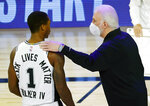 San Antonio Spurs head coach Gregg Popovich, right, talks with Lonnie Walker IV (1) during the first quarter of an NBA basketball game against the Utah Jazz, Thursday, Aug. 13, 2020, in Lake Buena Vista, Fla. (Kevin C. Cox/Pool Photo via AP)