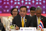 Thailand's Prime Minister Prayuth Chan-ocha speaks during the Association of Southeast Asian Nations (ASEAN) leaders summit plenary session in Bangkok, Thailand, Saturday, June 22, 2019. (AP Photo/Gemunu Amarasinghe)