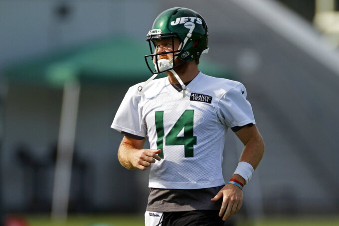 New York Jets quarterback Sam Darnold warms up during a practice at the NFL football team's training camp in Florham Park, N.J., Saturday, Aug. 22, 2020. (AP Photo/Adam Hunger)