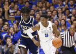 Duke's RJ Barrett (5) dribbles past Georgia Tech's Abdoulaye Gueye during the second half of an NCAA college basketball game in Durham, N.C., Saturday, Jan. 26, 2019. Duke won 66-53. (AP Photo/Gerry Broome)