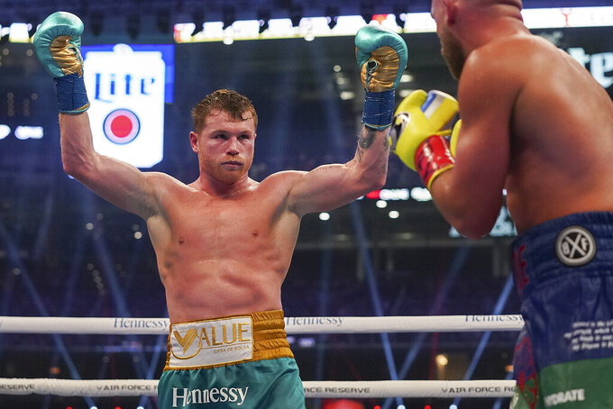 Canelo Alvarez reacts during a unified super middleweight world championship boxing match against Billy Joe Saunders, Saturday, May 8, 2021, in Arlington, Texas. (AP Photo/Jeffrey McWhorter)