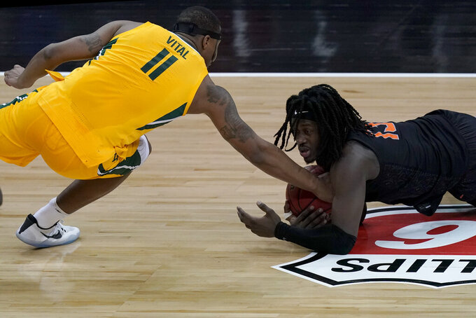 Baylor's Mark Vital (11) tries to steal the ball from Oklahoma State's Isaac Likekele during the second half of an NCAA college basketball game in the semifinals of the Big 12 tournament in Kansas City, Mo., Friday, March 12, 2021. (AP Photo/Charlie Riedel)