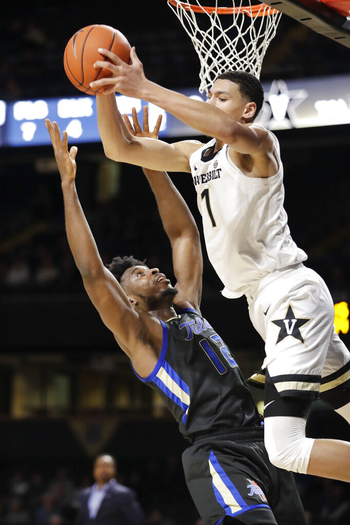 Vanderbilt forward Dylan Disu (1) pulls in a rebound over Tulsa center Emmanuel Ugboh (12) during the second half of an NCAA college basketball game Saturday, Nov. 30, 2019, in Nashville, Tenn. (AP Photo/Mark Humphrey)