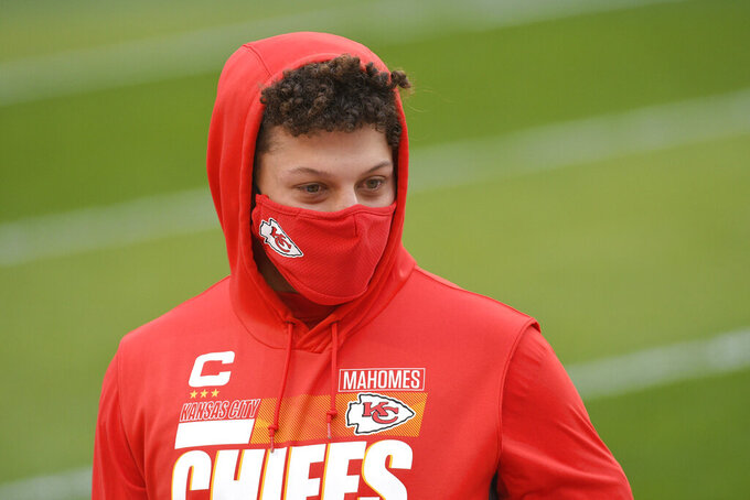 Kansas City Chiefs quarterback Patrick Mahomes walks on the field before the AFC championship NFL football game against the Buffalo Bills, Sunday, Jan. 24, 2021, in Kansas City, Mo. (AP Photo/Reed Hoffmann)