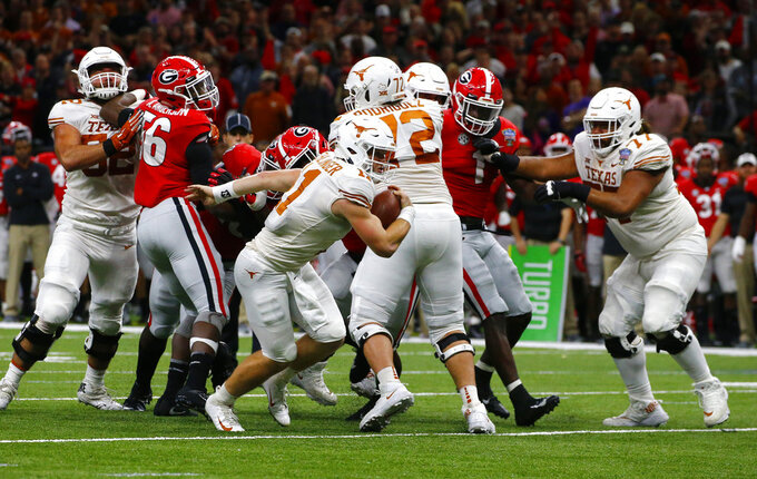 Texas quarterback Sam Ehlinger (11) breaks loose on a touchdown carry during the first half of the Sugar Bowl NCAA college football game against Georgia in New Orleans, Tuesday, Jan. 1, 2019. (AP Photo/Butch Dill)