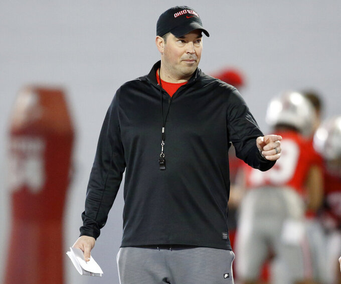 FILE - In this March 6, 2019, file photo, Ohio State University football coach Ryan Day gestures during an NCAA college football practice in Columbus, Ohio. Ohio State on Friday, March 19, 2021, opened what Day hopes will be an uninterrupted spring practice as he seeks a new starting quarterback and some normalcy after a tumultuous 2020. (AP Photo/Paul Vernon, File)