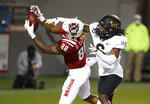 North Carolina State wide receiver Devin Carter (88) pulls in a 2-yard touchdown reception as Wake Forest defensive back Ja'Sir Taylor (6) tries to tip the ball away during the second half of an NCAA college football game in Raleigh, N.C, Saturday, Sept. 19, 2020. (Ethan Hyman/The News & Observer via AP)