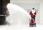 Don Rock clears snow from his driveway  on Monday, Feb. 15, 2021  in Owensboro, Ky.  (Alan Warren/The Messenger-Inquirer via AP)