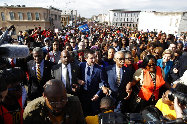 Democratic presidential candidate and former South Bend, Ind. Mayor Pete Buttigieg, the Rev, Al Sharpton, Democratic presidential candidate Sen. Amy Klobuchar, D-Minn., center, and Democratic presidential candidate Sen. Elizabeth Warren, D-Mass., walk across the Edmund Pettus Bridge in Selma, Ala., Sunday, March 1, 2020, to commemorate the 55th anniversary of