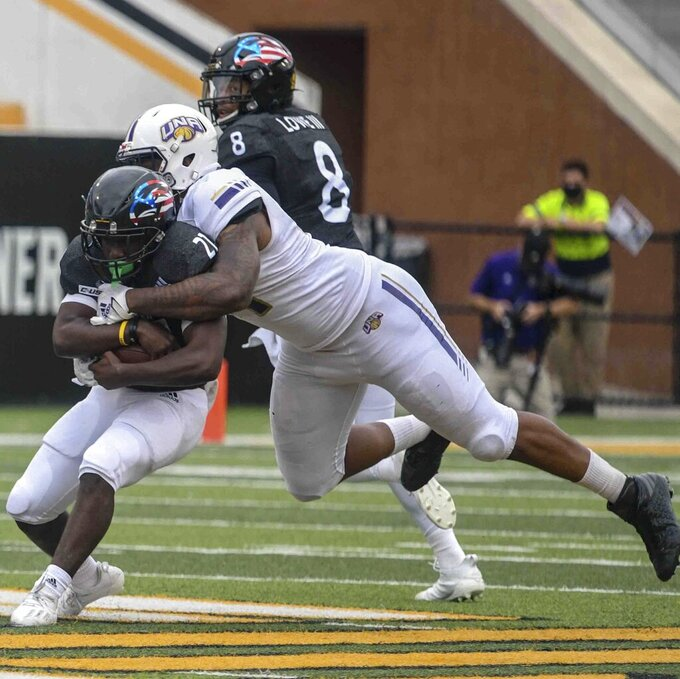 University of North Alabama Lions tackle Frank Gore Jr., Southern Miss running back, during the first half of their NCAA game at USM in Hattiesburg, Miss., Saturday, Nov. 7, 2020. (Cam Bonelli/Hattiesburg American via AP)