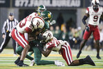 Oklahoma linebacker DaShaun White, left, and Brendan Radley-Hiles, right, make the tackle on Baylor wide receiver R.J. Sneed, center, after a reception during the first half of an NCAA college football game in Waco, Texas, Saturday, Nov. 16, 2019. (AP Photo/Ray Carlin)