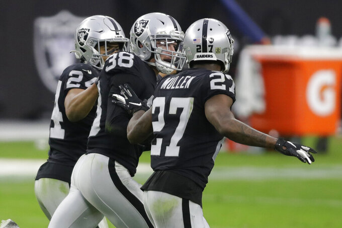 Las Vegas Raiders strong safety Jeff Heath (38) celebrates after making an interception against the Denver Broncos during the first half of an NFL football game, Sunday, Nov. 15, 2020, in Las Vegas. (AP Photo/Isaac Brekken)