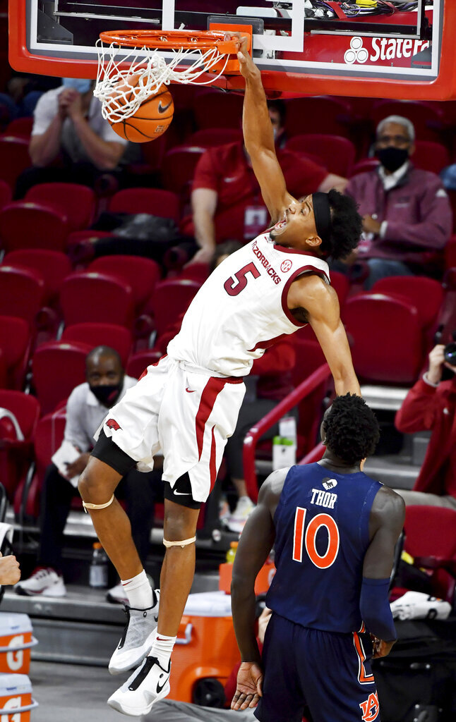 Arkansas guard Moses Moody (5) dunks against Auburn during the second half of an NCAA college basketball game Wednesday, Jan. 20, 2021, in Fayetteville, Ark. (AP Photo/Michael Woods)