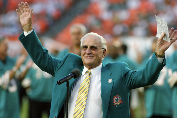 FILE - In this Oct. 25, 2009, file photo, former Miami Dolphins head coach Don Shula waves to the crowd during a half time ceremony of an NFL football game between the Miami Dolphins and the New Orleans Saints in Miami. Shula, who won the most games of any NFL coach and led the Miami Dolphins to the only perfect season in league history, died Monday, May 4, 2020, at his South Florida home, the team said. He was 90.  (AP Photo/Jeffrey M. Boan)