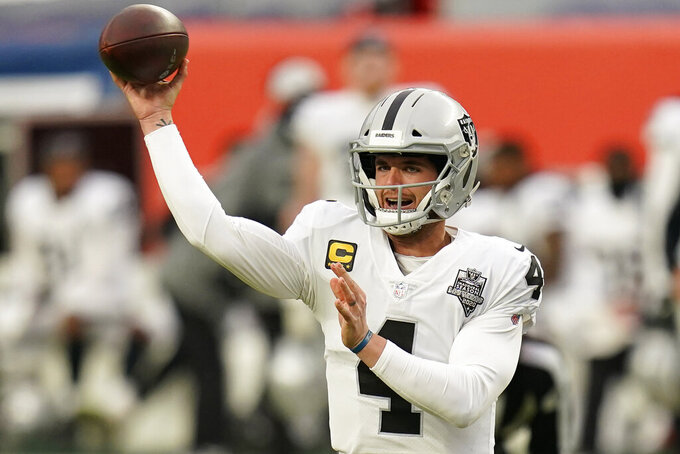 Las Vegas Raiders quarterback Derek Carr (4) throws against the Denver Broncos during the first half of an NFL football game, Sunday, Jan. 3, 2021, in Denver. (AP Photo/Jack Dempsey)