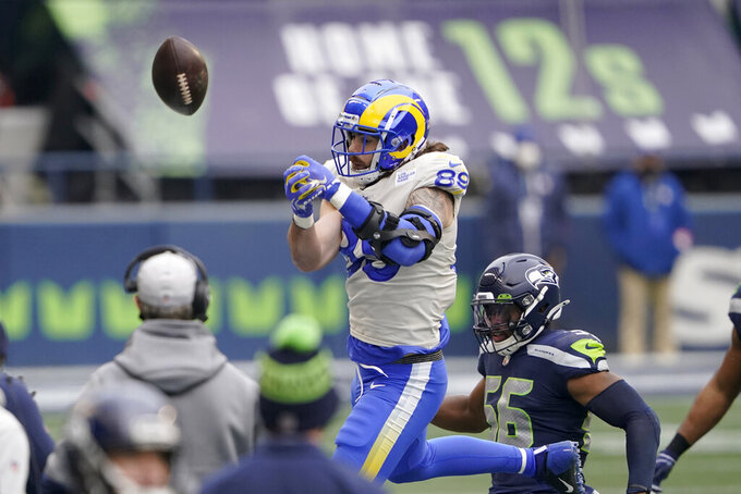 Los Angeles Rams tight end Tyler Higbee (89) cannot snag the ball on a pass-attempt as Seattle Seahawks outside linebacker Jordyn Brooks defends during the first half of an NFL wild-card playoff football game, Saturday, Jan. 9, 2021, in Seattle. (AP Photo/Ted S. Warren)