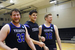 Yeshiva seniors and forwards Daniel Katz (33), Gabriel Leifer and Kevin Bokor (32) celebrate the team's 102-83 victory over Penn State-Harrisburg in the second round of the NCAA men's Division III college basketball tournament in Baltimore, Saturday, March, 7, 2020. (AP Photo/Jessie Wardarski)