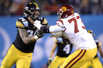Iowa defensive end A.J. Epenesa, left, is blocked by Southern California offensive tackle Austin Jackson (73) during the first half of the Holiday Bowl NCAA college football game Friday, Dec. 27, 2019, in San Diego. (AP Photo/Orlando Ramirez)