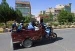 Afghan women and children travel in a motorcycle cart during fighting between Taliban and Afghan security forces in Herat province, west of Kabul, Afghanistan, Sunday, Aug. 1, 2021. (AP Photo/Hamed Sarfarazi)