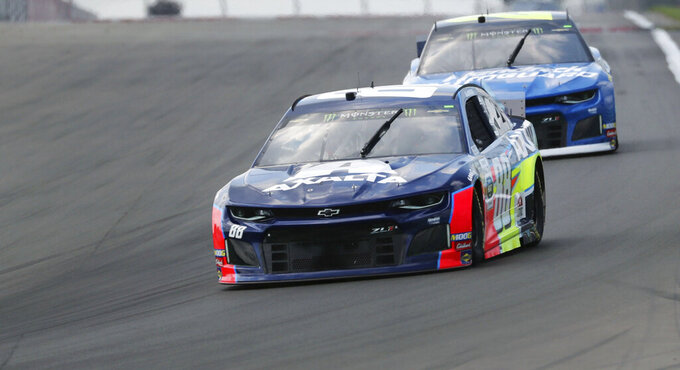 Alex Bowman heads into Turn 1 during a practice run for the NASCAR Cup Series auto race at Watkins Glen International, Saturday, Aug. 3, 2019, in Watkins Glen, N.Y. (AP Photo/John Munson)