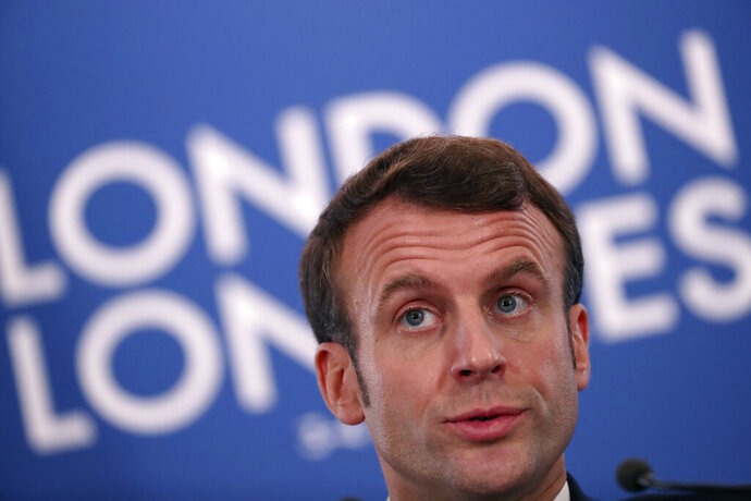French President Emmanuel Macron speaks during a media conference at the conclusion of a NATO leaders meeting at The Grove hotel and resort in Watford, Hertfordshire, England, Wednesday, Dec. 4, 2019. NATO Secretary-General Jens Stoltenberg rejected Wednesday French criticism that the military alliance is suffering from brain death, and insisted that the organization is adapting to modern challenges. (AP Photo/Francisco Seco)