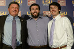 FILE - In this Nov. 26, 2016, file photo, LSU head coach Ed Orgeron, left, poses with two of his sons, Tyler, center, and Cody, during an NCAA college football news conference in Baton Rouge, La. LSU is sticking with Orgeron, giving the interim football coach his dream job on a permanent basis. LSU coach Ed Orgeron, who helps oversee the defensive line, likes nothing more than seeing his pass rushers cause misery for opposing quarterbacks. This week, the opposing quarterback will be his son, Cody, setting up an unusual matchup for both the Tigers' coach and McNeese State's signal caller. (Hilary Scheinuk/The Advocate via AP, File)